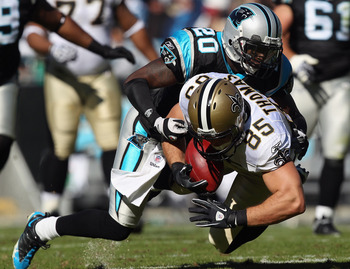 CHARLOTTE, NC - NOVEMBER 07:  David Thomas #85 of the New Orleans Saints is tackled by Chris Gamble #20 of the Carolina Panthers during their game at Bank of America Stadium on November 7, 2010 in Charlotte, North Carolina.  (Photo by Streeter Lecka/Getty