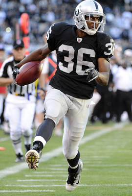 OAKLAND, CA - AUGUST 28: Taiwan Jones #36 of the Oakland Raiders runs twenty two yards for a touchdown against the New Orleans Saints in the third quarter during an NFL pre-season football game at the O.co Coliseum August 28, 2011 in Oakland, California.