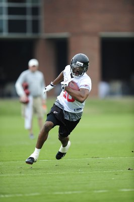 FLOWERY BRANCH, GA - MAY 9: Safety Marcus Paschal #40 of the Atlanta Falcons returns an interception during minicamp at the Falcons Complex on May 9, 2009 in Flowery Branch, Georgia. (Paul Abell/Getty Images)