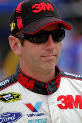 BRISTOL, TN - AUGUST 26:  Greg Biffle, driver of the #16 Roush Fenway Racing Ford, looks on during qualifying for the NASCAR Sprint Cup Series IRWIN Tools Night Race at Bristol Motor Speedway on August 26, 2011 in Bristol, Tennessee.  (Photo by Jerry Mark