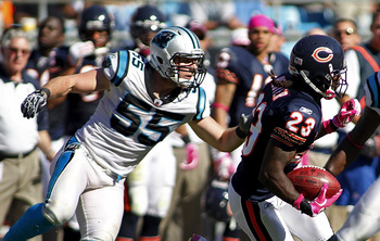 CHARLOTTE, NC - OCTOBER 10: Wide receiver Devin Hester #23 of the Chicago Bears runs with the ball as linebacker Dan Connor #55 of the Carolina Panthers, linebacker Nic Harris #59 of the Carolina Panthers, and cornerback Robert McClain #36 of the Carolina