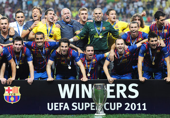 MONACO - AUGUST 26: Barcelona players (L-R) Lionel Messi, Daniel Alves, Cesc Fabregas, Xavi Hernandez, Andres Iniesta and David Villa of Barcelona celebrate with the trophy during the UEFA Super Cup match between FC Barcelona and FC Porto at Louis II Stad