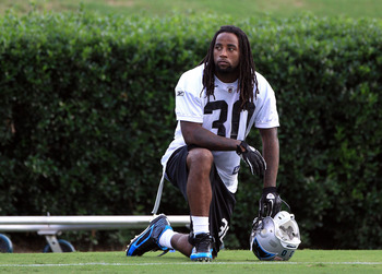 SPARTANBURG, SC - JULY 30:  Charles Godfrey #30 of the Carolina Panthers takes a break on the practice field during training camp at Wofford College on July 30, 2011 in Spartanburg, South Carolina.  (Photo by Streeter Lecka/Getty Images)