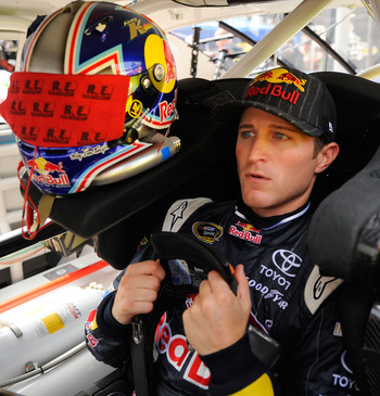 BRISTOL, TN - AUGUST 26:  Kasey Kahne, driver of the #4 Red Bull Toyota, sits in his car during practice for the NASCAR Sprint Cup Series IRWIN Tools Night Race at Bristol Motor Speedway on August 26, 2011 in Bristol, Tennessee.  (Photo by Jason Smith/Get