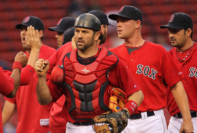 BOSTON, MA - AUGUST 27:  Jason Varitek #33 of the Boston Red Sox and Michael Bowden #64 of the Boston Red Sox celebrate their 9-3 win over the Oakland Athletics at Fenway Park August 27, 2011 in Boston, Massachusetts. (Photo by Jim Rogash/Getty Images)