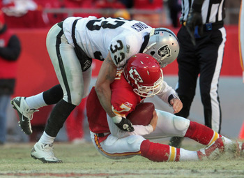 KANSAS CITY, MO - JANUARY 02:  Quarterback Matt Cassel #7 of the Kansas City Chiefs is sacked by Tyvon Branch #7 of the Oakland Raiders during the game on January 2, 2011 at Arrowhead Stadium in Kansas City, Missouri.  (Photo by Jamie Squire/Getty Images)