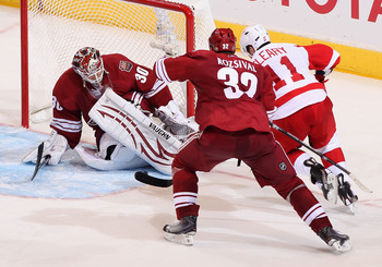 GLENDALE, AZ - APRIL 20:  Goaltender Ilya Bryzgalov #30 of the Phoenix Coyotes makes a pad save on the shot as Daniel Cleary #11 of the Detroit Red Wings skates in in Game Four of the Western Conference Quarterfinals during the 2011 NHL Stanley Cup Playof