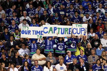 VANCOUVER, BC - JUNE 15:  Vancouver Canucks fans hold a sign that reads, 'IT'S OUR TIME TO CAPTURE THE CUP!' during Game Seven between the Vancouver Canucks and the Boston Bruins in the 2011 NHL Stanley Cup Final at Rogers Arena on June 15, 2011 in Vancou