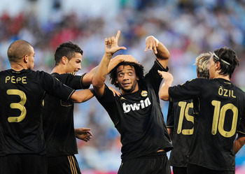 ZARAGOZA, SPAIN - AUGUST 28:  Marcelo (C) of Real Madrid celebrates after scoring Real's 2nd goal during the La Liga match between Real Zaragoza and Real Madrid at estadio La Romareda on August 28, 2011 in Zaragoza, Spain.  (Photo by Denis Doyle/Getty Ima