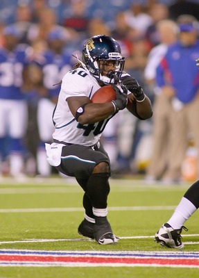 ORCHARD PARK, NY - AUGUST 27:  DuJuan Harris #40 of the Jacksonville Jaguars runs against the Buffalo Bills at Ralph Wilson Stadium on August 27, 2011 in Orchard Park, New York .Buffalo won 35-32 in overtime  (Photo by Rick Stewart/Getty Images)