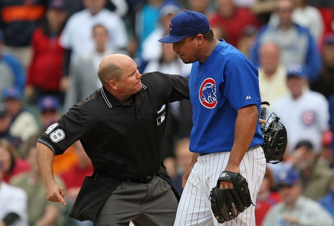 CHICAGO - MAY 27: Home plate umpire Mark Carlson #48 ejects starting pitcher Carlos Zambrano #38 of the Chicago Cubs after an arguement over a play at the plate between Zambrano and Nyjer Morgan of the Pittsburgh Pirates on May 27, 2009 at Wrigley Field i