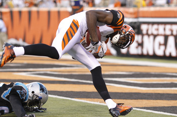 CINCINNATI, OH - AUGUST 25: A.J. Green #18 of the Cincinnati Bengals keeps his balance to score a touchdown on a 40-yard reception during an NFL preseason game against the Carolina Panthers at Paul Brown Stadium on August 25, 2011 in Cincinnati, Ohio. The