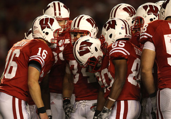 MADISON, WI - OCTOBER 16: Scott Tolzien #16 of the Wisconsin Badgers calls a play in the huddle against the Ohio State Buckeyes at Camp Randall Stadium on October 16, 2010 in Madison, Wisconsin. Wisconsin defeated Ohio State 31-18. (Photo by Jonathan Dani