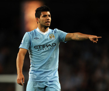 MANCHESTER, ENGLAND - AUGUST 15:  Sergio Aguero of Manchester City gestures during the Barclays Premier League match between Manchester City and Swansea City at Etihad Stadium on August 15, 2011 in Manchester, England.  (Photo by Chris Brunskill/Getty Ima