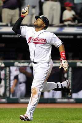 CLEVELAND, OH - AUGUST 29: Carlos Santana #41 of the Cleveland Indians celebrates after hitting a solo home run during the seventh inning against the Oakland Athletics at Progressive Field on August 29, 2011 in Cleveland, Ohio. (Photo by Jason Miller/Gett