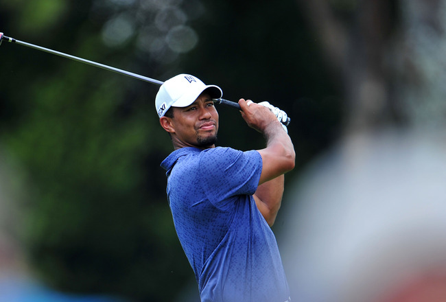 JOHNS CREEK, GA - AUGUST 12:  Tiger Woods plays a shot during the second round of the 93rd PGA Championship at the Atlanta Athletic Club on August 12, 2011 in Johns Creek, Georgia.  (Photo by Stuart Franklin/Getty Images)