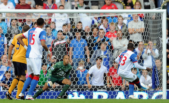 BLACKBURN, ENGLAND - AUGUST 27:  Junior Hoilett of Blackburn Rovers has his penalty saved by Tim Howard of Everton during the Barclays Premier League match between Blackburn Rovers and Everton at Ewood Park on August 27, 2011 in Blackburn, England.  (Phot