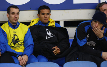 LIVERPOOL, ENGLAND - FEBRUARY 05: Tim Cahill  of Everton sits on the subsitutes bench before the start of the Barclays Premier League match between Everton and Blackpool at Goodison Park on February 5, 2011 in Liverpool, England.  (Photo by Clive Brunskil