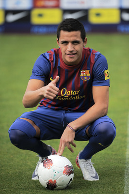 BARCELONA, SPAIN - JULY 25:  Alexis Sanchez from Chile poses during his presentation as the new signing for FC Barcelona, at the Joan Gamper training camp sports complex on July 25, 2011 in Barcelona, Spain.  (Photo by David Ramos/Getty Images)