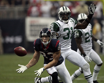 HOUSTON - AUGUST 15:  Wide receiver Kevin Walter #83 of the Houston Texans completes a catch in front of cornerback Antonio  Cromartie #31 of the New York Jets at Reliant Stadium on August 15, 2011 in Houston, Texas.  (Photo by Bob Levey/Getty Images)