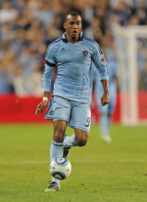 KANSAS CITY, KS - AUGUST 06:  Mid fielder Teal Bunbury #9 of Sporting Kansas City   controls the ball during a game against the Seattle Sounders FC in the second half on August 6, 2011 at LiveStrong Sporting Park in Kansas City, Kansas.  (Photo by Peter G