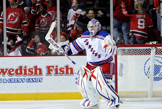 NEWARK, NJ - MARCH 25:  Henrik Lundqvist #30 of the New York Rangers celebrates in win over the New Jersey Devils at the Prudential Center on March 25, 2010 in Newark, New Jersey.  The Rangers won 4-3 in a shootout. (Photo by Jeff Zelevansky/Getty Images)