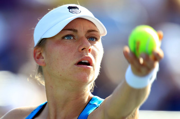 NEW YORK, NY - AUGUST 29:  Vera Zvonareva of Russia prepares to serve against Stephanie Foretz Gacon of France during Day One of the 2011 US Open at the USTA Billie Jean King National Tennis Center on August 29, 2011 in the Flushing neighborhood of the Qu