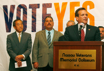 UNIONDALE, NY - AUGUST 01: Nassau County Executive Ed Mangano (R) addresses the media to announce that the new arena voter referendum failed as New York Islanders owner Charles Wang (L) looks on at the Nassau Coliseum on August 1, 2011 in Uniondale, New Y