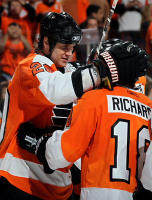 PHILADELPHIA - MAY 24:  Chris Pronger #20 and Mike Richards #18 of the Philadelphia Flyers celebrate after defeating the Montreal Canadiens by a score of 4-2 to win Game 5 of the Eastern Conference Finals and to advance to the 2010 NHL Stanley Cup Finals