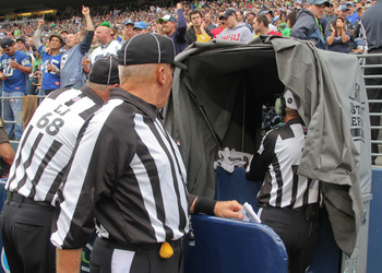 SEATTLE - SEPTEMBER 26:  Referees review a play during the game between the Seattle Seahawks and the San Diego Chargers at Qwest Field on September 26, 2010 in Seattle, Washington. (Photo by Otto Greule Jr/Getty Images)