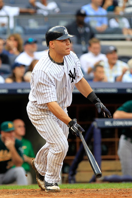 NEW YORK, NY - AUGUST 25:  Russell Martin #55 of the New York Yankees hits a grand slam home run in the 6th inning against the Oakland Athletics on August 25, 2011 at Yankee Stadium in the Bronx borough of New York City.  (Photo by Chris Trotman/Getty Ima