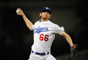 LOS ANGELES, CA - AUGUST 08:  Pitcher Mike MacDougal #66 of the Los Angeles Dodgers  throws a pitch against the Philadelphia Phillies during the baseball game at Dodger Stadium on August 8, 2011 in Los Angeles, California.  (Photo by Kevork Djansezian/Get