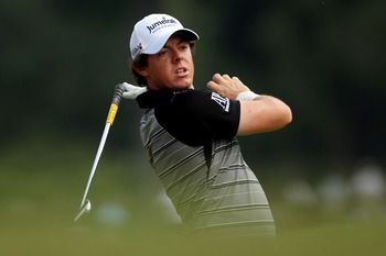 JOHNS CREEK, GA - AUGUST 13:  Rory McIlroy of Northern Ireland hits his second shot on the second hole during the third round of the 93rd PGA Championship at the Atlanta Athletic Club on August 13, 2011 in Johns Creek, Georgia.  (Photo by Andrew Redington