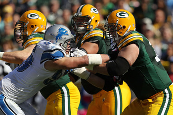 GREEN BAY, WI - OCTOBER 03: Chad Clifton #76 of the Green Bay Packers blocks Kyle Vanden Bosch #93 of the Detroit Lions at Lambeau Field on October 3, 2010 in Green Bay, Wisconsin. The Packers defeated the Lions 28-26. (Photo by Jonathan Daniel/Getty Imag