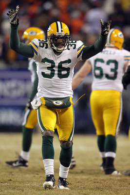 CHICAGO, IL - JANUARY 23:  Nick Collins #36 of the Green Bay Packers celebrates after Sam Shields #37 seals the win with a fourth quarter interception against the Chicago Bears in the NFC Championship Game at Soldier Field on January 23, 2011 in Chicago,