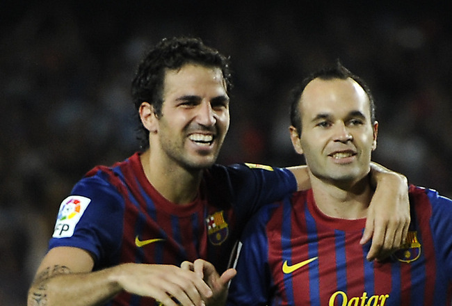 BARCELONA, SPAIN - AUGUST 29:   Cesc Fabregas of FC Barcelona (L) and his teammate Andres Iniesta celebrates after Lionel Messi scored his fourth team's goal during the La Liga match between FC Barcelona and Villarreal CF at Camp Nou on August 29, 2011 in