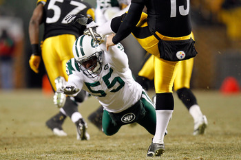 PITTSBURGH, PA - JANUARY 23:  Jamaal Westerman #55 of the New York Jets attempts to block a punt by Jeremy Kapinos #13 of the Pittsburgh Steelers and is called for roughing the kicker in the third quarter of the 2011 AFC Championship game at Heinz Field o