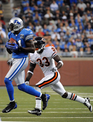 DETROIT - OCTOBER 05:  Roy Williams #11 of the Detroit Lions fumbles the ball after a pass in front of Charles Tillman #33 of the Chicago Bears during the quarter at Ford Field on October 5, 2008 in Detroit, Michigan.  The video ruling was an incomplete p