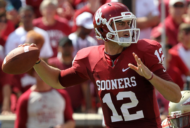 NORMAN, OK - SEPTEMBER 11:  Quarterback Landry Jones #12 of the Oklahoma Sooners drops back to pass against the Florida State Seminoles in the first quarter at Gaylord Family Oklahoma Memorial Stadium on September 11, 2010 in Norman, Oklahoma.  (Photo by