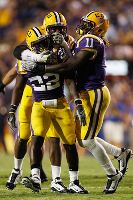 BATON ROUGE, LA - OCTOBER 16:  Ryan Baker #22 celebrates after a sack with Kelvin Sheppard #11 of the Louisiana State University Tigers during the game against the McNeese State Cowboys at Tiger Stadium on October 16, 2010 in Baton Rouge, Louisiana.  The