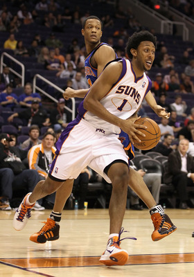 PHOENIX, AZ - JANUARY 07:  Josh Childress #1 of the Phoenix Suns drives the ball during the NBA game against the New York Knicks at US Airways Center on January 7, 2011 in Phoenix, Arizona.  The Knicks defeated the Suns 121-96.  NOTE TO USER: User express