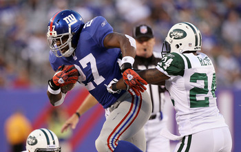 EAST RUTHERFORD, NJ - AUGUST 29:  Brandon Jacobs #27 of the New York Giants runs the ball against Darrelle Revis #24 of the New York Jets during their pre season game on August 29, 2011 at MetLife Stadium in East Rutherford, New Jersey.  (Photo by Jim McI