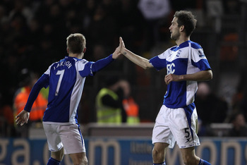 BLACKPOOL, ENGLAND - JANUARY 04:  Scott Dann of Birmingham City celebrates with Sebastian Larsson after scoring the winning goal during the Barclays Premier League match between Blackpool and Birmingham City at Bloomfield Road on January 4, 2011 in Blackp