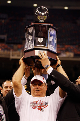 NEW ORLEANS, LA - DECEMBER 18:  Head coach Larry Blakeney of the Troy University Trojans holds the championship trophy after defeating the Ohio University Bobcats 48-21 during the R&L Carriers New Orleans Bowl at the Louisiana Superdome on December 18, 20