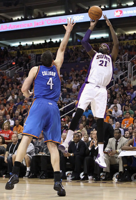 PHOENIX, AZ - MARCH 30:  Hakim Warrick #21 of the Phoenix Suns puts up a shot over Nick Collison #4 of the Oklahoma City Thunder during the NBA game at US Airways Center on March 30, 2011 in Phoenix, Arizona. The Thunder defeated the Suns 116-98. NOTE TO