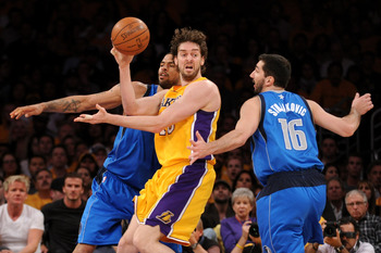 LOS ANGELES, CA - MAY 02:  Pau Gasol #16 of the Los Angeles Lakers passes the ball as he is double-teammed by Tyson Chandler #6 and Peja Stojakovic #16 of the Dallas Mavericks in Game One of the Western Conference Semifinals in the 2011 NBA Playoffs at St