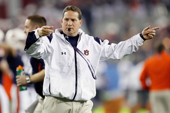 GLENDALE, AZ - JANUARY 10:  Head coach Gene Chizik of the Auburn Tigers directs his team before taking on the Oregon Ducks during the Tostitos BCS National Championship Game at University of Phoenix Stadium on January 10, 2011 in Glendale, Arizona.  (Phot