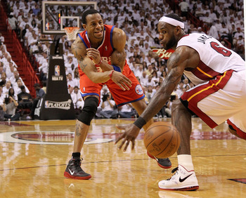 MIAMI, FL - APRIL 18:  Andre Iguodala #9 of the Philadelphia 76ers passes around LeBron James #6 of the Miami Heat  during game two of the Eastern Conference Quarterfinals  at American Airlines Arena on April 18, 2011 in Miami, Florida. NOTE TO USER: User
