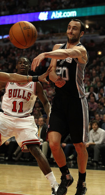 CHICAGO, IL - FEBRUARY 17: Manu Ginobili #20 of the San Antonio Spurs passes the ball after eluding Ronnie Brewer #11 of the Chicago Bulls at the United Center on February 17, 2011 in Chicago, Illinois. The Bulls defeated the Spurs 109-99. NOTE TO USER: U