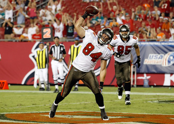 TAMPA, FL - AUGUST 27:  Tightend Nathan Overbay #84 of the Tampa Bay Buccaneers celebrates a fourth quarter touchdown against the Miami Dolphins during a preseason game at Raymond James Stadium on August 27, 2011 in Tampa, Florida.  (Photo by J. Meric/Get
